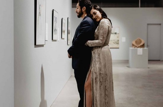 engagement session of couple viewing art inside art center