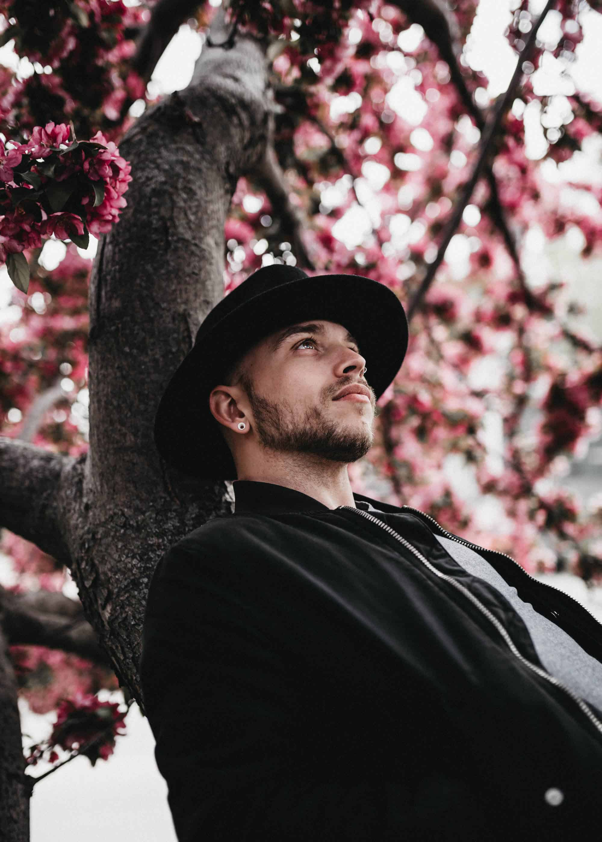 portrait of man sitting on a cherry blossom tree