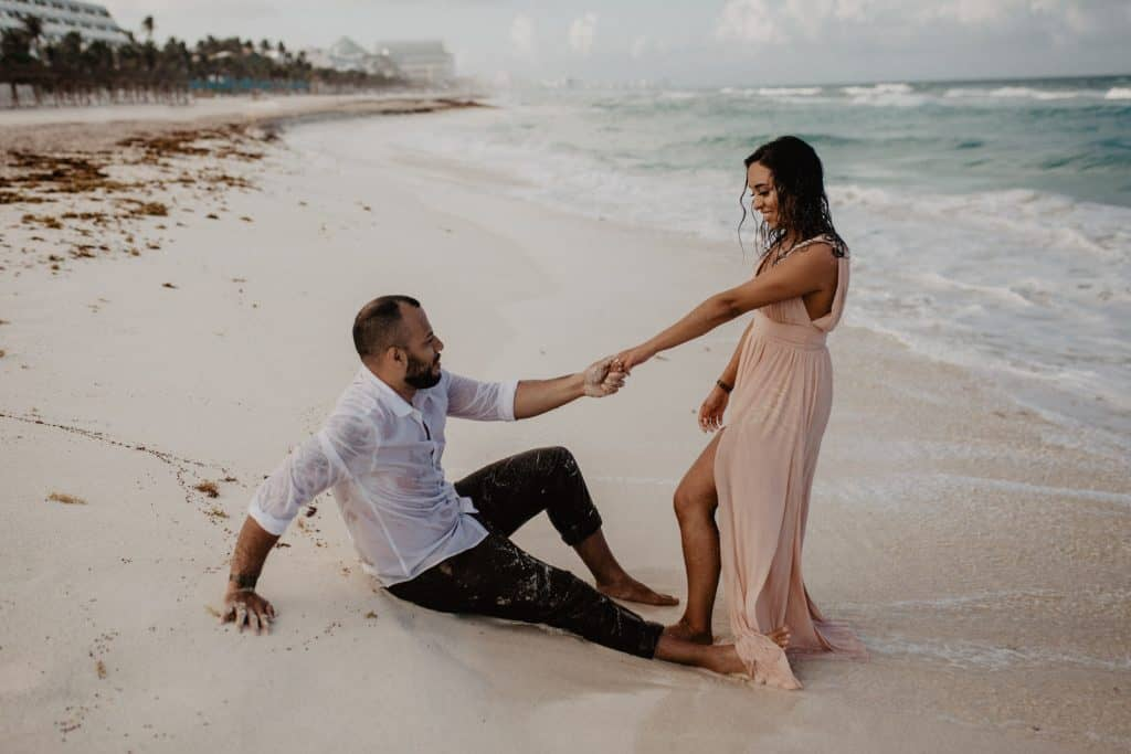 couple in beach in Cancun Mexico, adventure engagement session