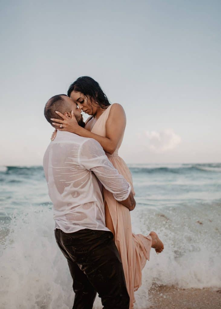 couple in the beach in Cancun Mexico, adventure engagement session