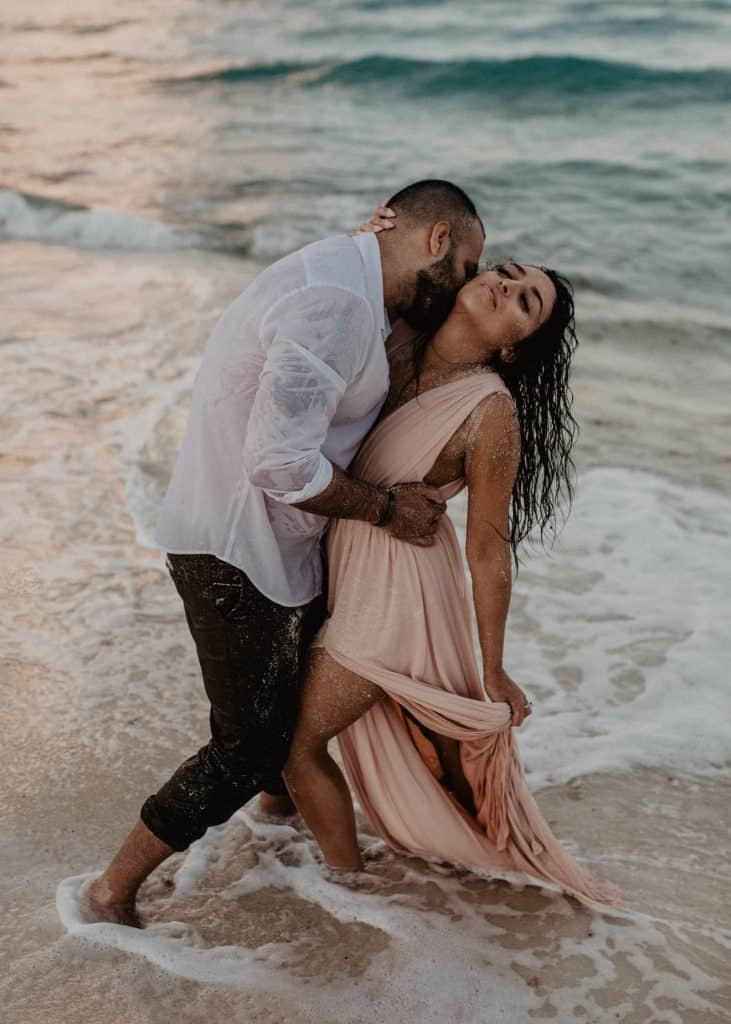 couple kissing in the beach in Cancun Mexico, adventure engagement session