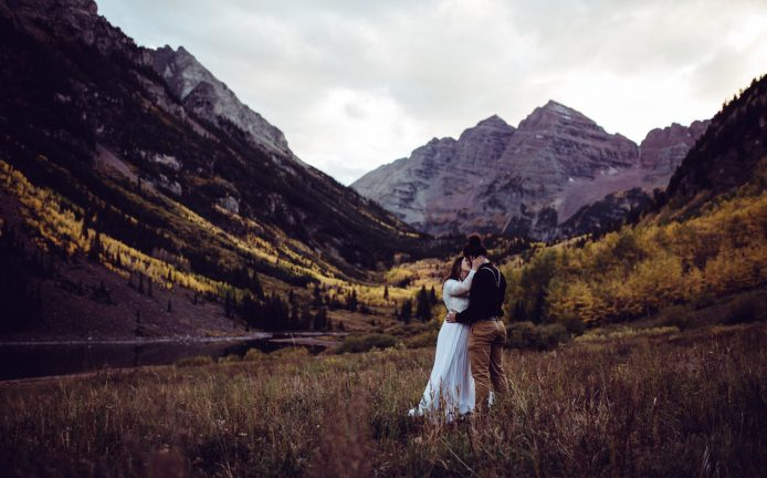 Elopement couple in Aspen Colorado Maroon Bells during fall