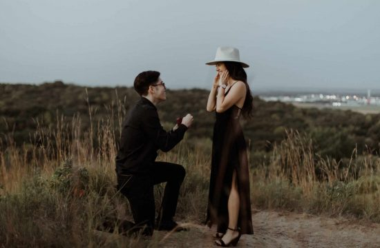 guy in one knee proposing to his girlfriend