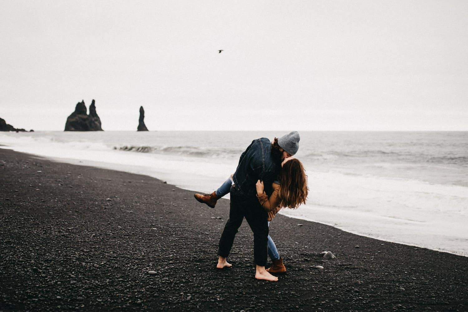 couple at the black sand beach in Iceland