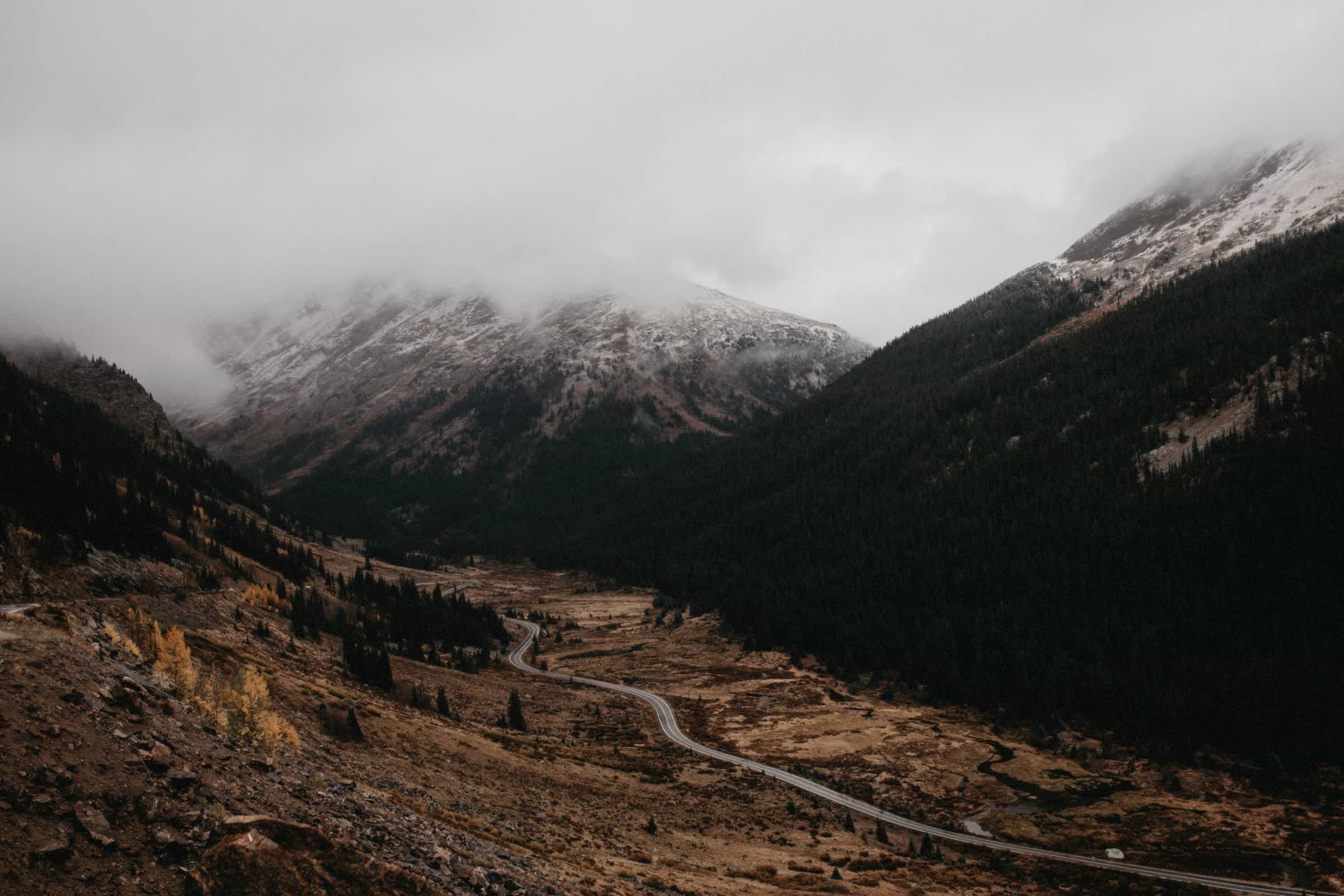 Downwards view of Independence Pass in Colorado during a foggy and snowy day