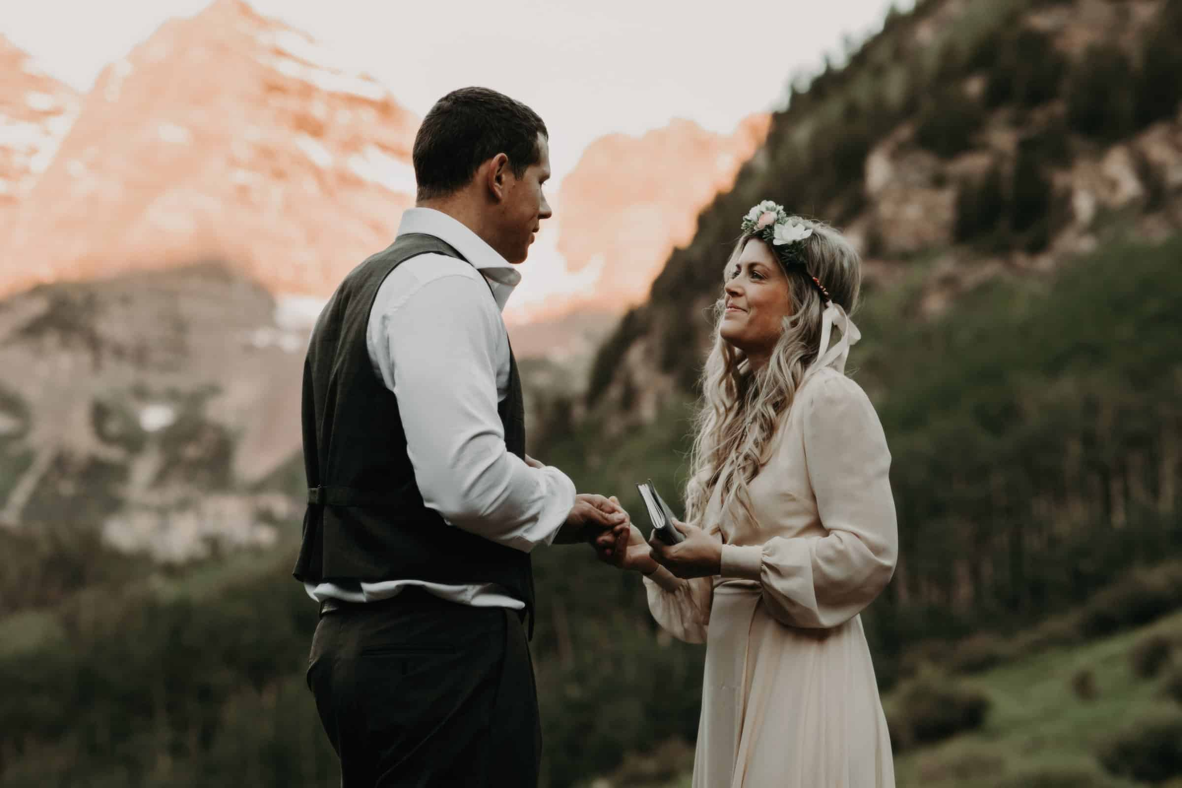 couple exchanging vows during an outdoor ceremony at the Aspen Colorado Maroon Bells