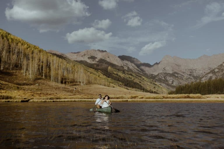 Couple canoeing at Piney River Ranch during their adventure elopement in Colorado